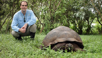 Posing with a Galapagos Tortoise