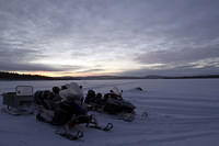 Snowmobiling on Lake Inari on our way to ice fishing