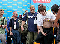 Even after eating 63 hotdogs, Kobayashi can still show off his abs.